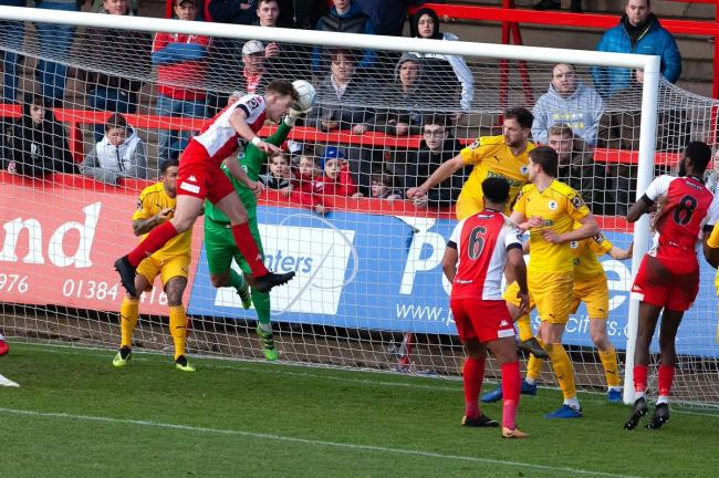 Joe Ironside scores against Chester. Photo by Paul France