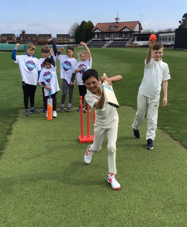 Seb Hilliard and Alex Morgan test out KCC's new artificial wicket cheered on by other juniors at the club's CricketForce weekend.