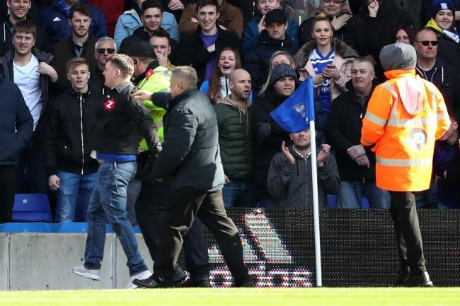 Rubery man Paul Mitchell being dragged off the pitch at St Andrew's Stadium. Photo by PA